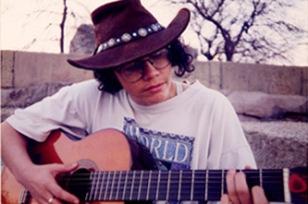 Schuy plays guitar